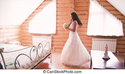 bride in white gown in a log house 1