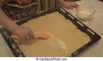 Children's hand brush smearing mayonnaise on the test -...