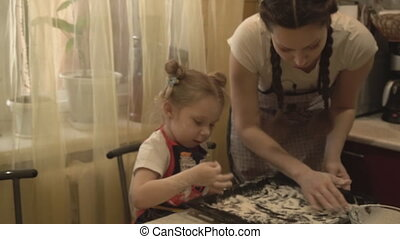 The girl and her mother trying on a necklace of olives -...