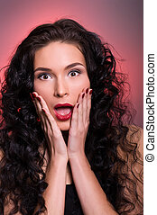 Portrait of young beautiful brunette screaming woman