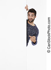 Pointing to blank space - Portrait of man pointing to blank...