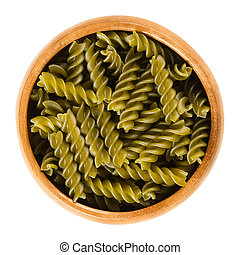 Green peas fusilli pasta in wooden bowl over white - Green...