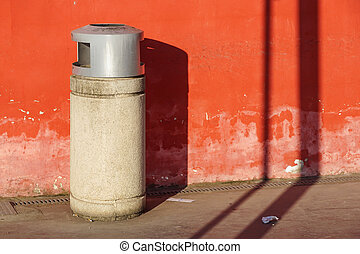 trash can trashcan dustbin garbage rubbish bins waste round outside in street against brick wall with brick copy space residential .