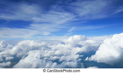 View from the airplane window - Clouds. View from the...