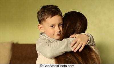 The happy boy tenderly embraced his mother - The child...