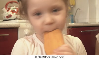 The girl licks a spoon of pizza