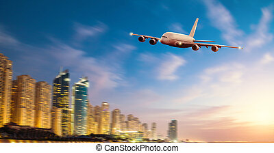 Front view of commercial airplane, blur modern city on...