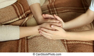 The child tenderly embraced my mother's hands.full hd video...