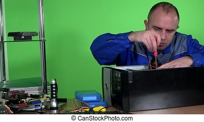 Technician repairing computer hardware take out power supply...