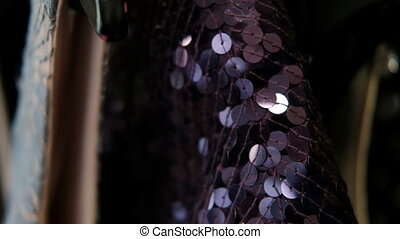 Clothing made from purple sequins hangs on a hanger. A new...