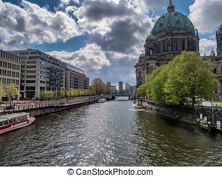 River Spree with tour boats in Berlin Mitte, Germany