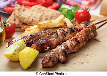 Grilled meat skewers on a table - Grilled meat skewers on a...