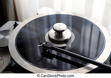 Vintage record player with tonearm closeup view