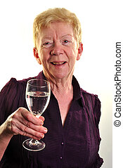 an old age woman is holding a glass of water