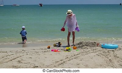 children playing on the beach on a Sunny day