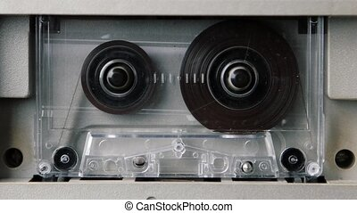 Audio cassette playing. Seamless looping. Contains alpha matte.