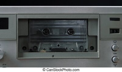 Audio cassette playing. Cassette in cassette player