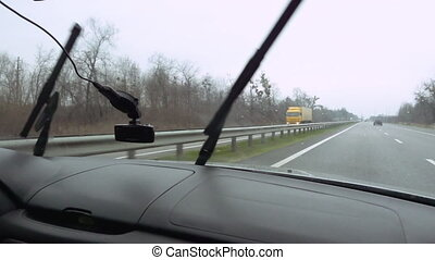 Windshield wipers on highway slow motion - Windshield wipers...