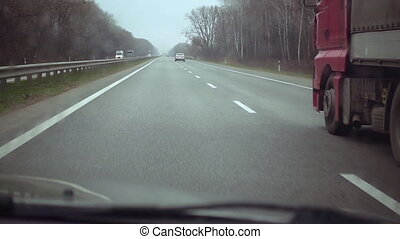 Car passes the truck on highway - Car overtakes the truck on...