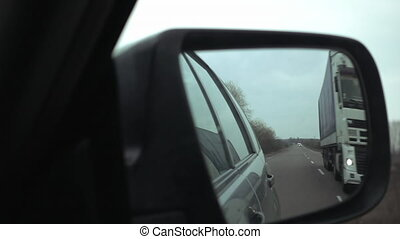 Side mirror view of passing the truck on highway - Car...