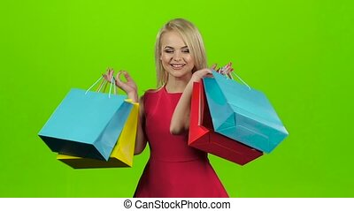 Happy shopping woman excited and cheerful. Green screen studio