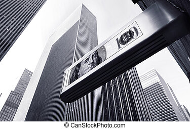 business - dollar sign in front of office buildings