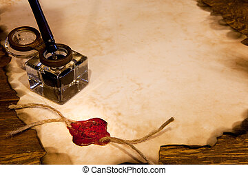 Wax seal and ink - Old ink pot on a parchment scroll with...