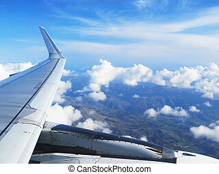 Wing of the plane on blue sky background