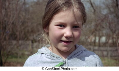 Cute blond little girl puts out her tongue - Cute blond...