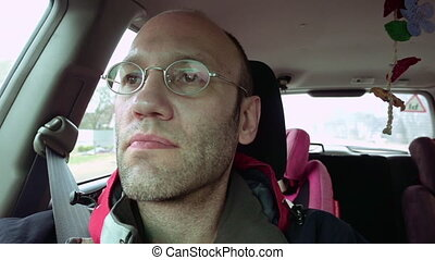 Passenger in the car slow motion - Adult passenger in...