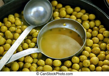 olives in pickling brine background texture - olives in...