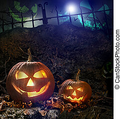 Halloween pumpkins on rocks at night - Halloween pumpkins on...