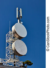 Telecommunication mast with microwave links and cellular...
