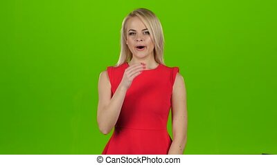 Woman yawns covering her mouth with hands. Green screen...