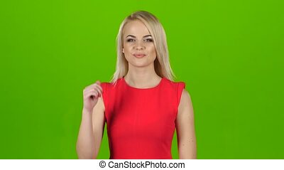 Happy blonde shows gesture all right with both hands. Studio...