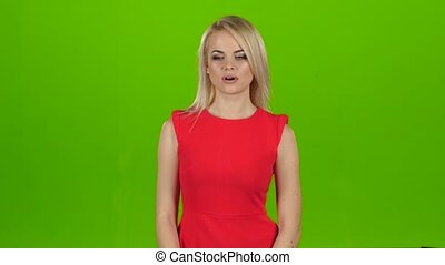 Blonde yawns covering her mouth with hand. Green screen...