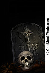 Spooky tombstone with skull on black background