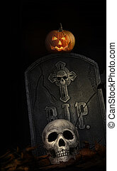 Spooky tombstone with skull and pumpkin on black background