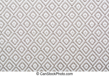 Linen napkin with a clear geometric pattern. Diamonds and squares.