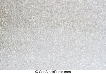 Texture of thermal insulating styrofoam close-up. Structure polystyrene plastic, light grey color. For background, design with copy space text or image