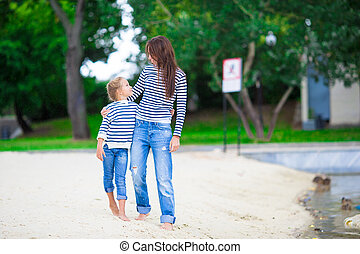 Happy mom and adorable little girl enjoying summer weekend -...