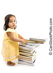 Baby and Book - Happy Baby with a pile of books .