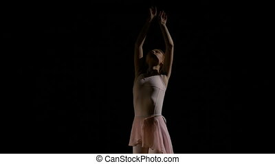Beautiful ballerina performing pirouette in ballet recital