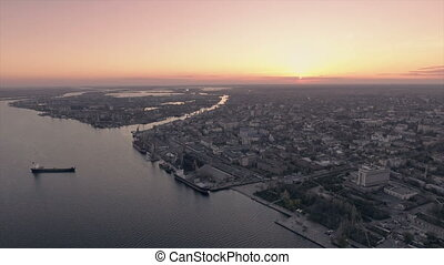 Aerial shot of Kherson river embankment at sunset in early spring in Ukraine