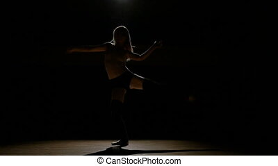Girl dancer doing work out elements of contemporary dance in...