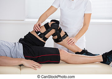 Physiotherapist Giving Leg Exercise