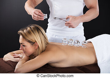 Smiling Woman Receiving Cupping Treatment On Back - Smiling...