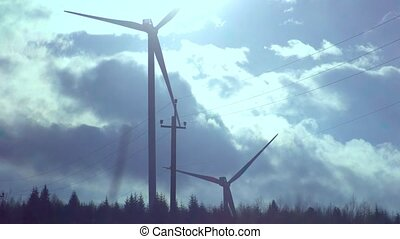 Wind power plant with sky and clouds in a blue gradings -...