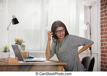 Businesswoman Having Back Pain