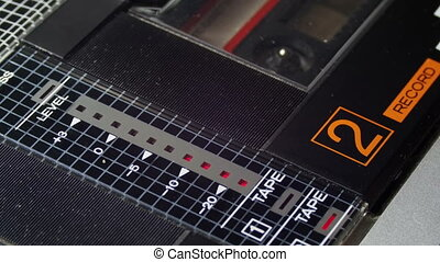 Playing an Audio Cassette in a Vintage Tape Recorder....